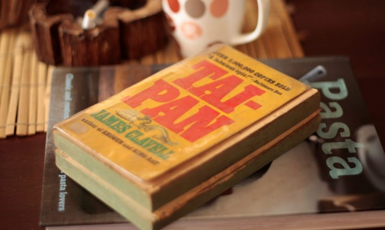 A tattered paperback copy of James Clavell's Tai-Pan