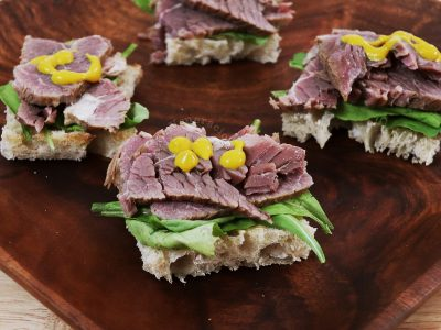 Open-faced sandwiches with homemade slow cooker corned beef