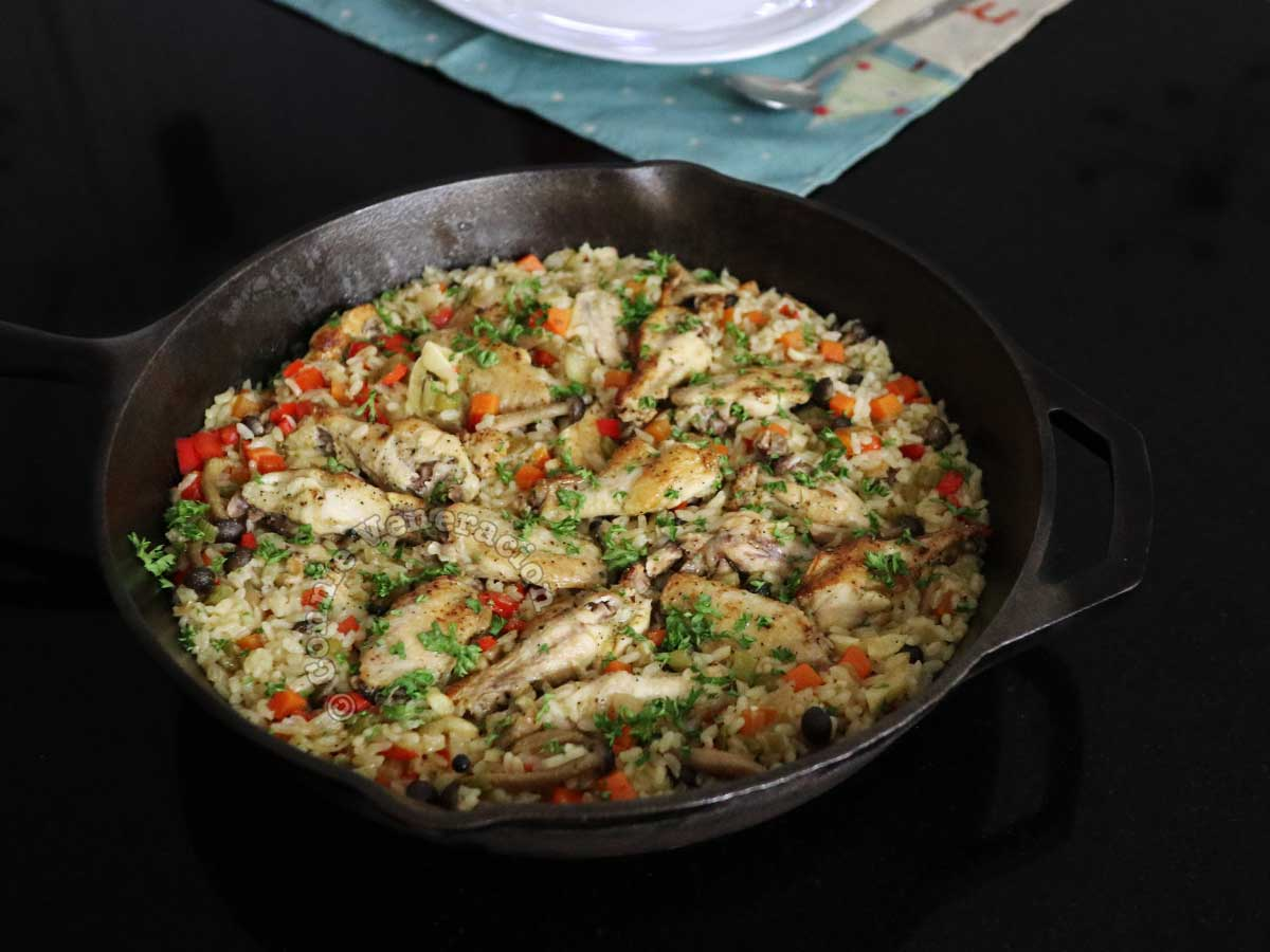 Chicken and mushrooms rice casserole in cast iron pan