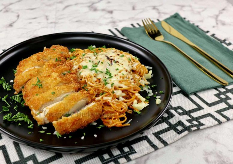 Chicken fried steaks, cooked katsu style, served with spaghetti