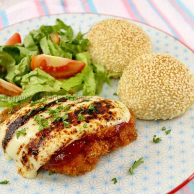 Chicken Parmigiana served with side salad and dinner rolls