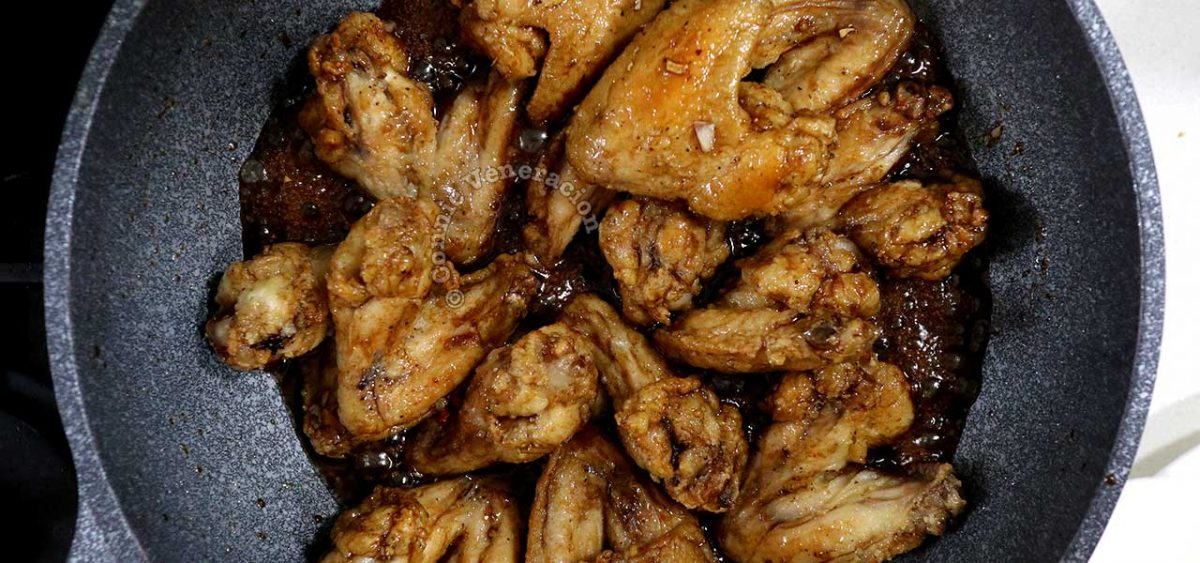 Tossing fried chicken in chili honey balsamic sauce