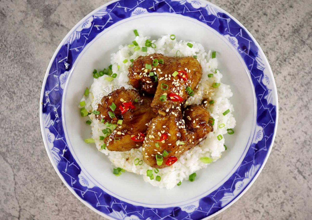Chili Honey Balsamic Chicken Wings Sprinkled With Toasted Sesame Seeds, Sliced Chilies and Scallions
