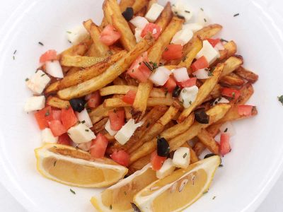 Greek-inspired Fries with lemon wedges