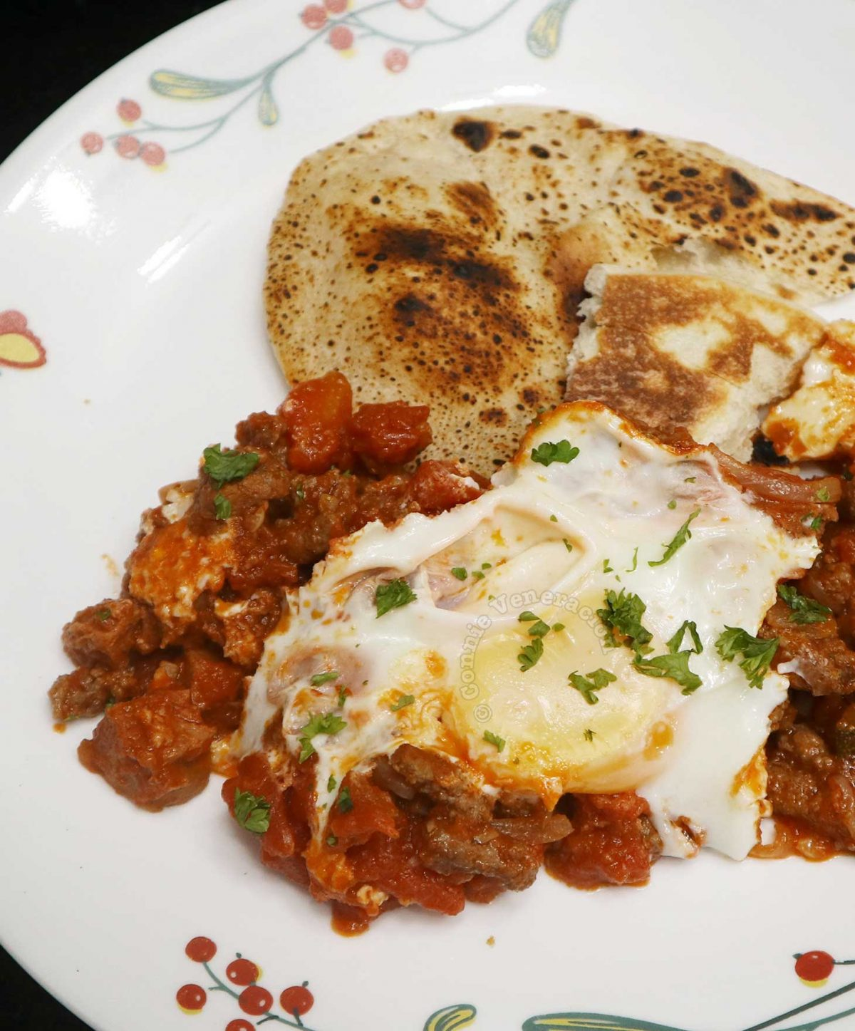 Shakshuka (Eggs in Tomato Stew) Served with Naan