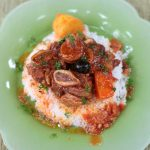 Slow Cooker Beef Stew Served Over Rice