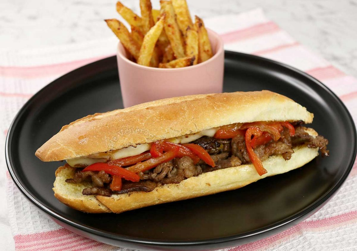 Pepper Cheesesteak Sandwich Served With Fries