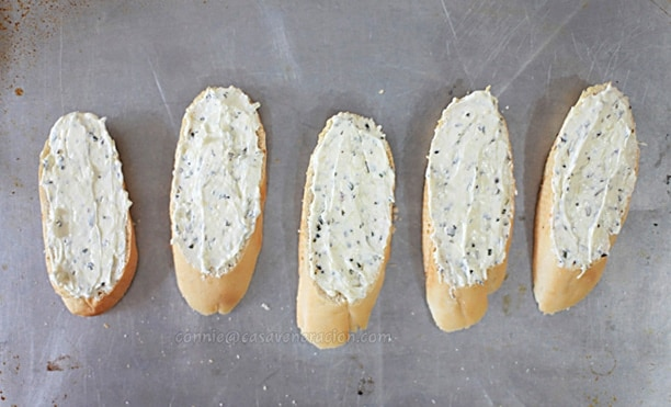 Baguette slices spread with mayo-cream cheese