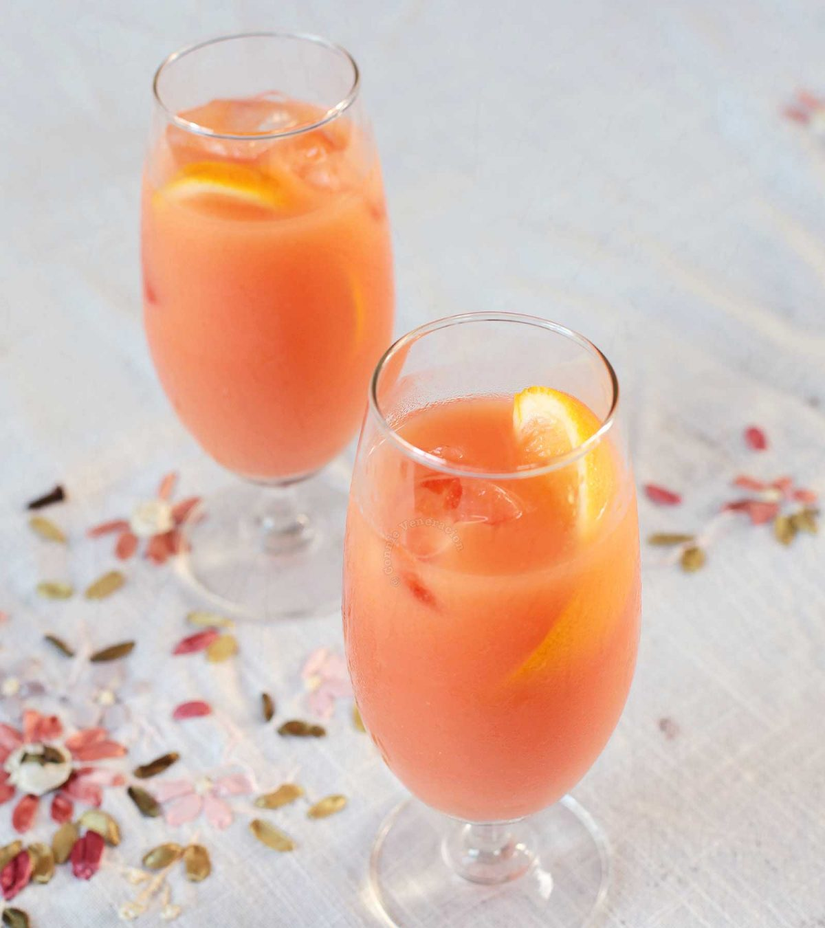 Campari orange cocktail served with orange twists