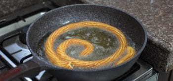 Golden fried choux pastry in hot oil