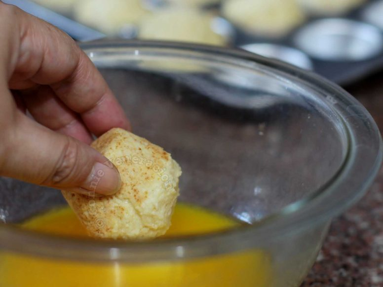 Dipping hot muffins in melted butter