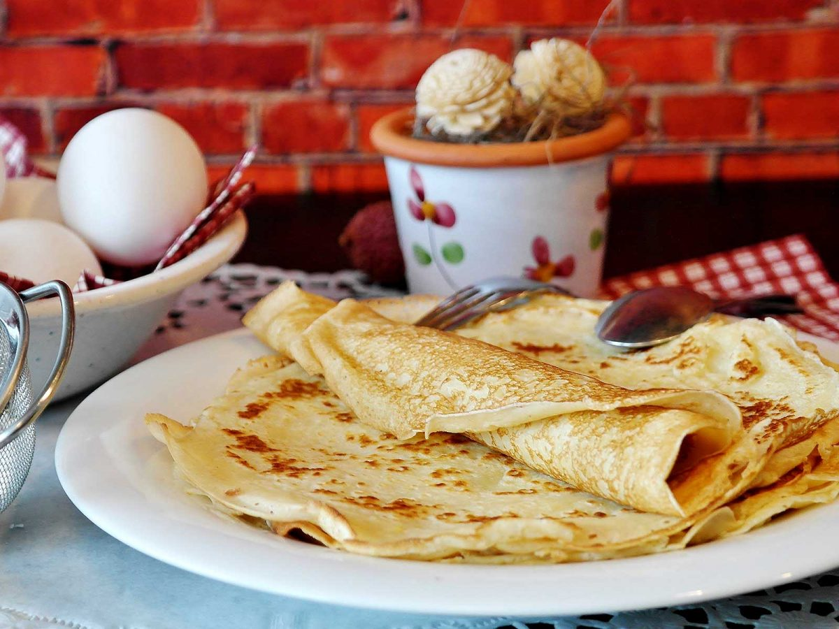A stack of crepes on a plate