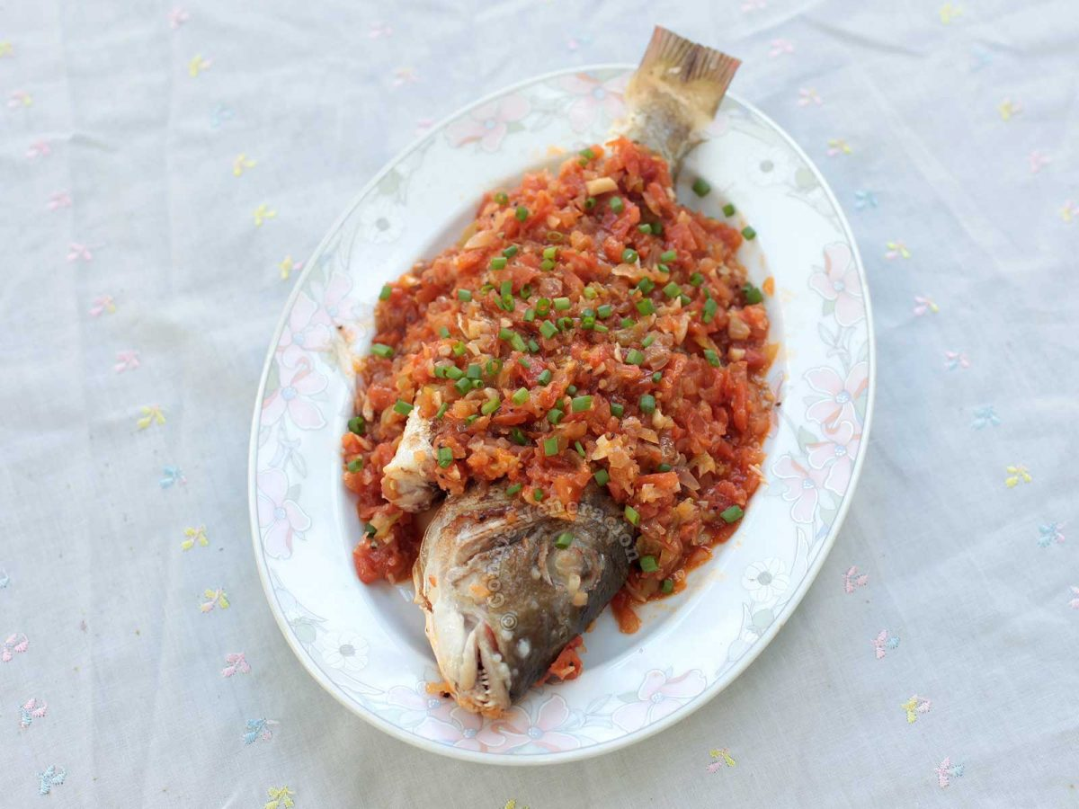 Grilled Fish smothered with onion and tomato