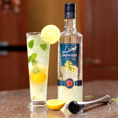 Muddled cocktail drink with Limoncello