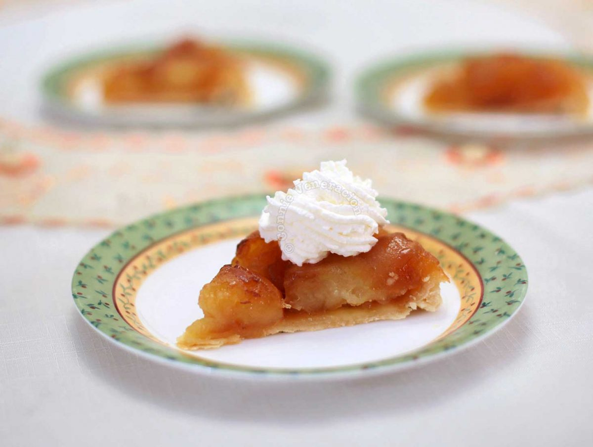 Tarte Tatin topped with whipped cream