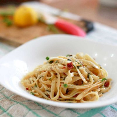 Fettuccine Aglio e Olio with Sun-dried Tomatoes in White Bowl