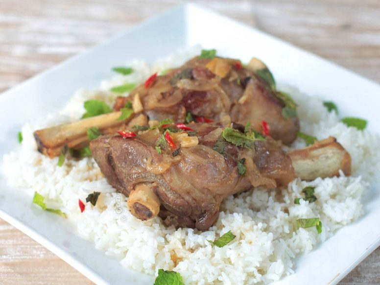 Braised Lamb Shanks Served Over Rice
