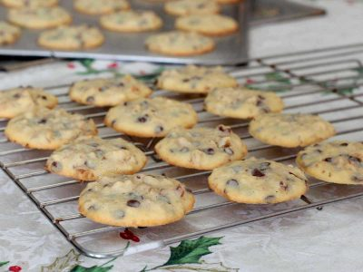 Chocolate chip and walnut cookies cooling on a rack