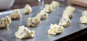 Chocolate chip and walnut cookie dough on baking tray