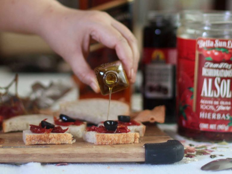 Drizzling truffle oil over canapes