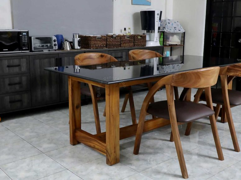 Dining table with granite top and solid wood frame