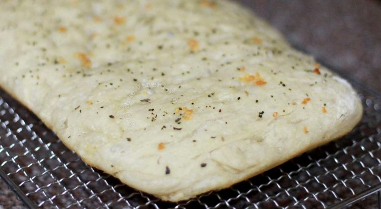 Focaccia cooling on a rack