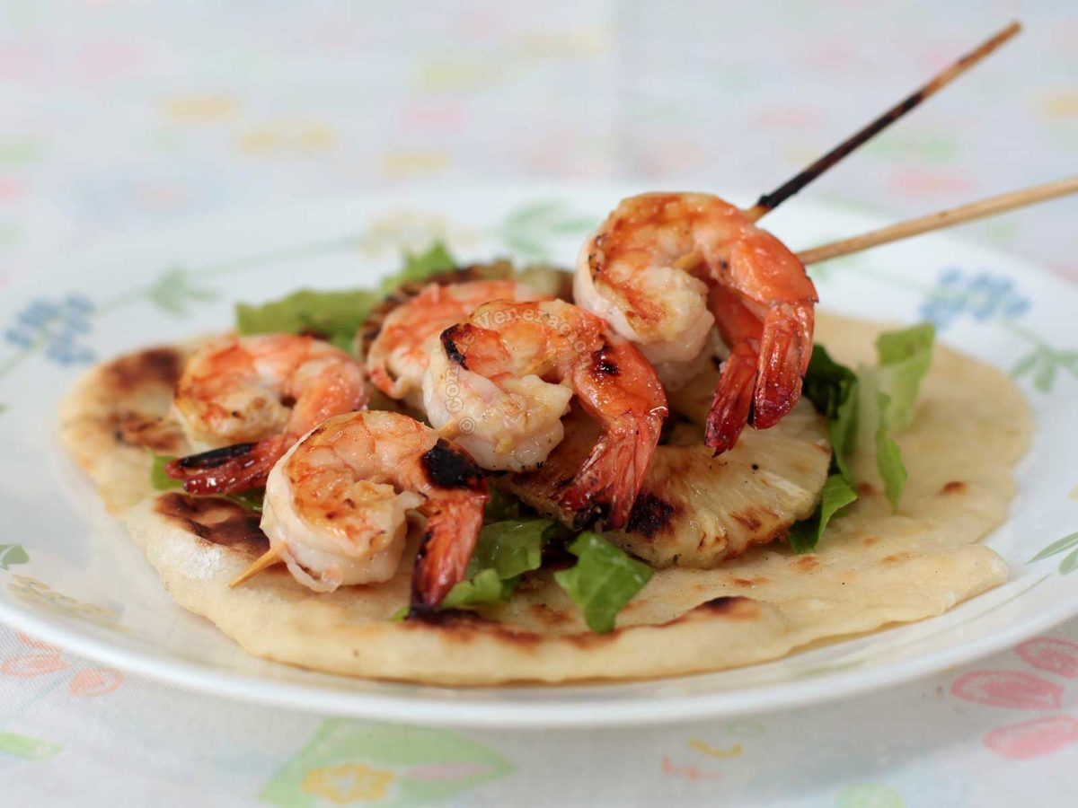 Chili Lime Shrimp Skewers Served with Pineapple and Tortilla