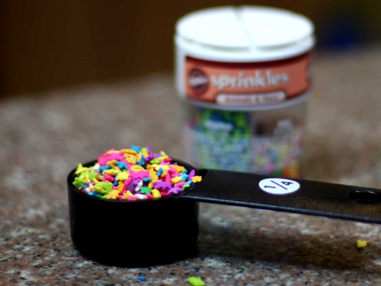 Nonpareils or sprinkles in a measuring cup