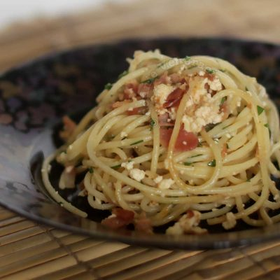 Spaghetti with Bacon and Ricotta in Black Bowl