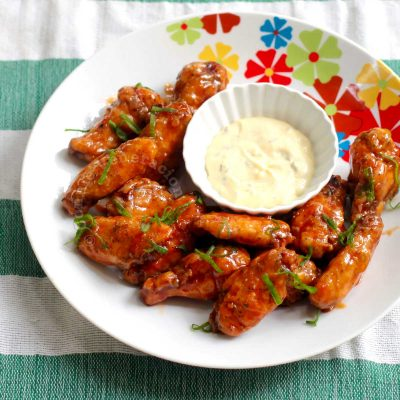 Baked Buffalo Chicken Wings Arranged on a Plate