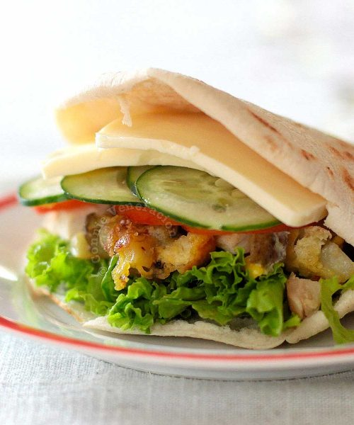 Pita stuffed with potato omelette, cheese, lettuce, cucumber and tomato