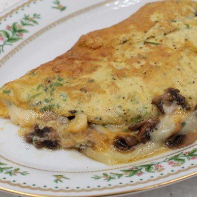 Light and fully cheese and mushroom omelette with cheese oozing our