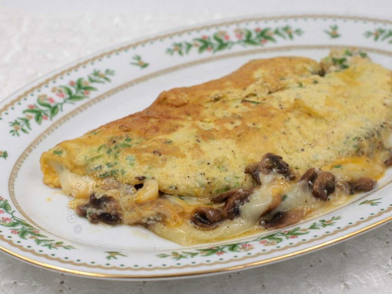 Light and fully cheese and mushroom omelette