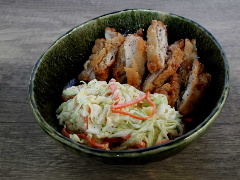 Cabbage, Carrot and Pineapple Coleslaw with Fried Chicken Fillet Served in Green Stoneware Bowl