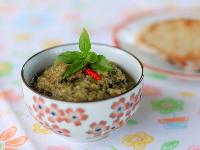 Eggplant caviar in a white bowl with red flowers
