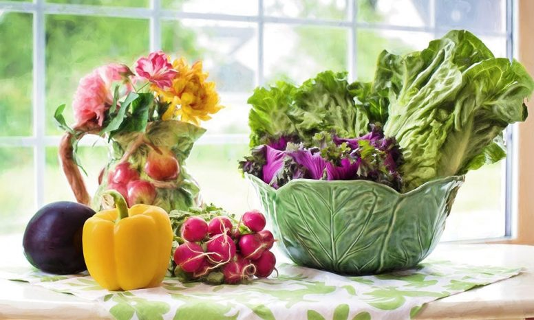 Fruits and vegetables on a table by the window