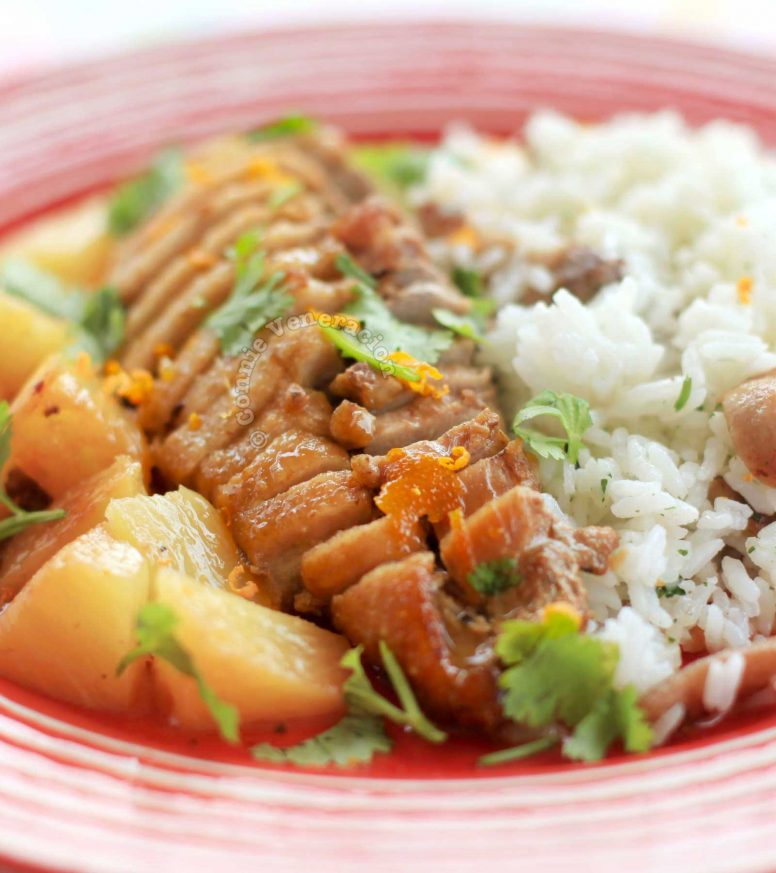 Pineapple orange duck and rice in red plate