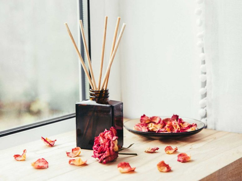 Reed oil diffuser by the window