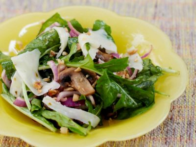 Rocket (arugula) and mushroom salad with red onion and shaved cheese