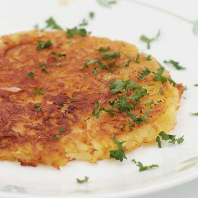 Rösti (Swiss Fried Grated Potatoes) Sprinkled with Parsley
