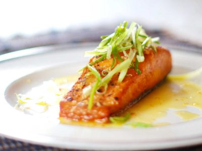 Pan-grilled Salmon With Lemon-butter-garlic Sauce Garnished with Scallions