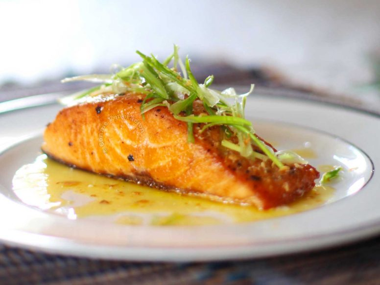 Pan-grilled Salmon With Lemon-butter-garlic Sauce in White Plate