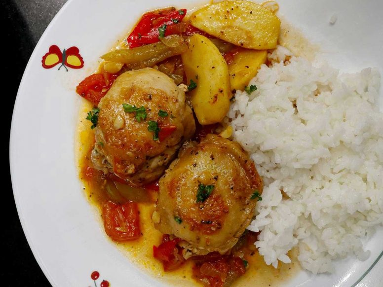 Chicken apple stew with rice on plate