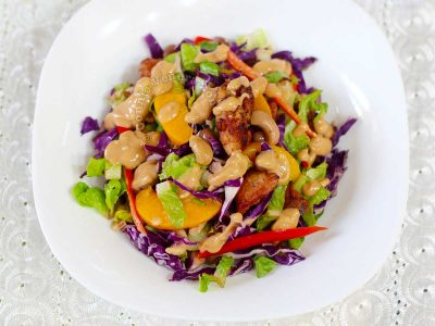 Fried chicken and red cabbage salad with peanut dressing