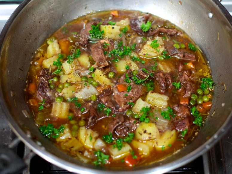 Holiday beef stew in pan