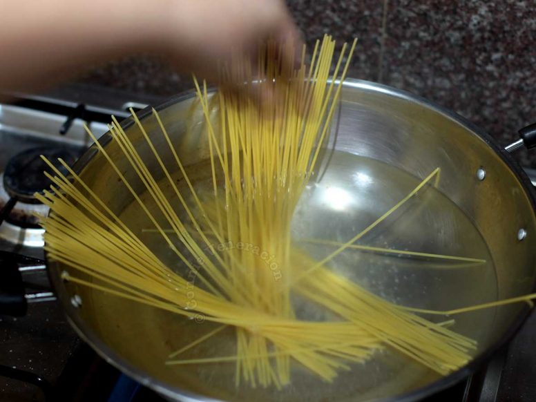 Dropping pasta into boiling water