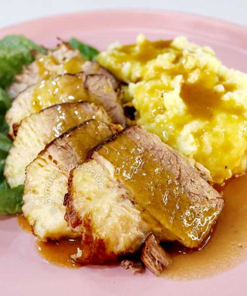 Pot roast and gravy with mashed potatoes