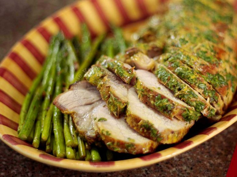 Roast pork coated with mustard and chopped fresh thyme