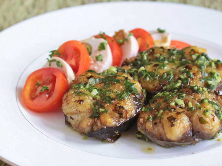 Fried fish steaks topped with pesto