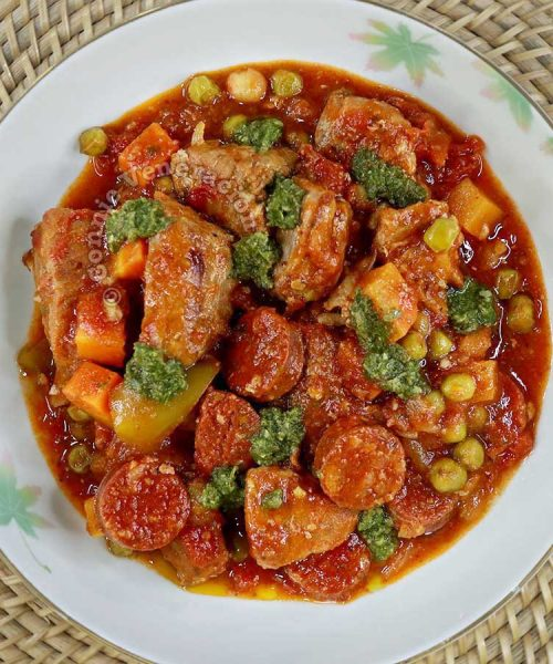Pork and sausage stew in tomato sauce